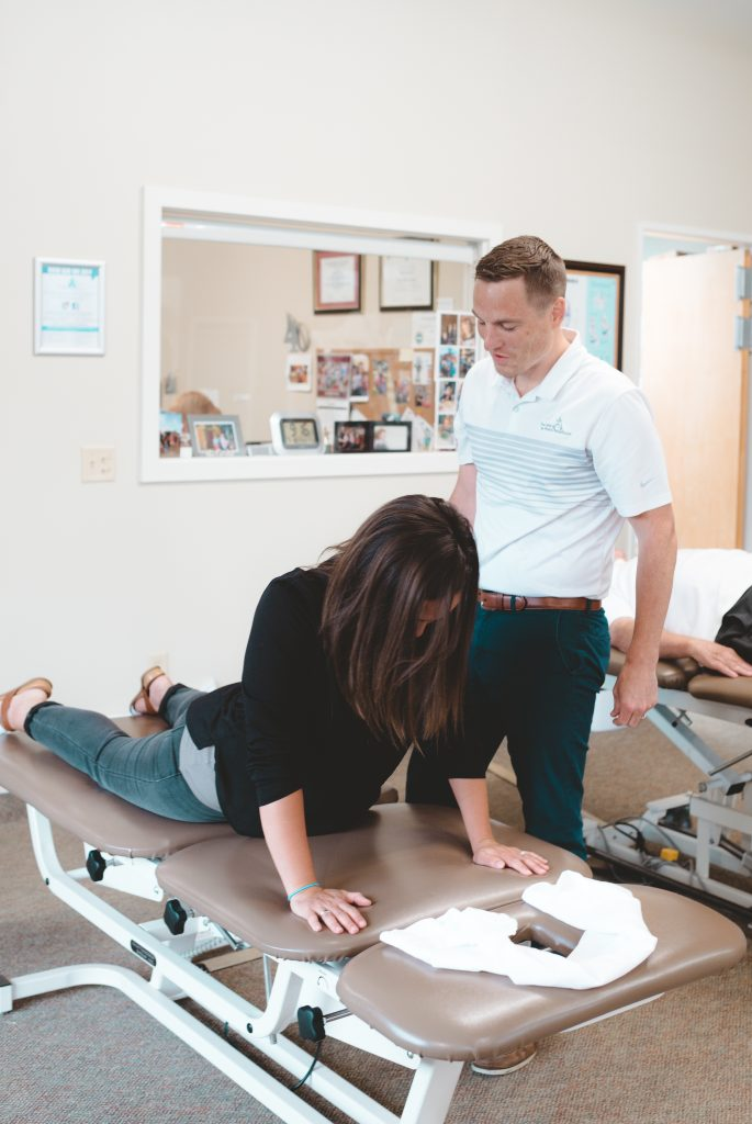Patient doing back exercise on table