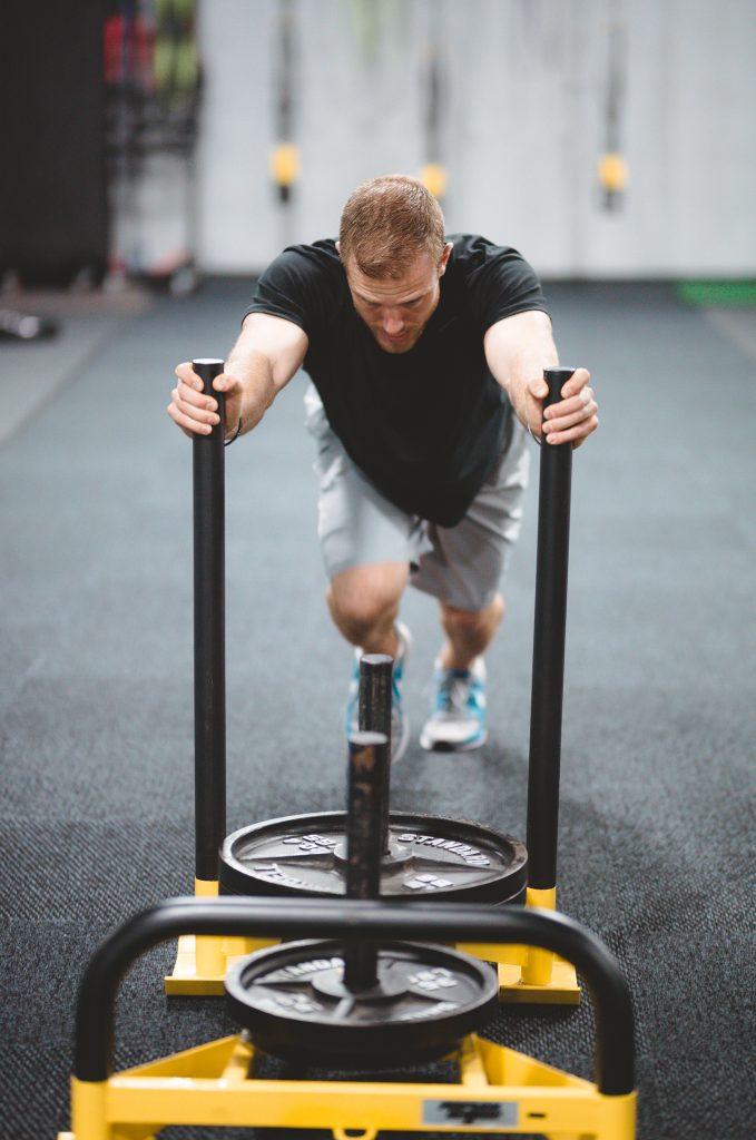 Athlete pushing weighted sled
