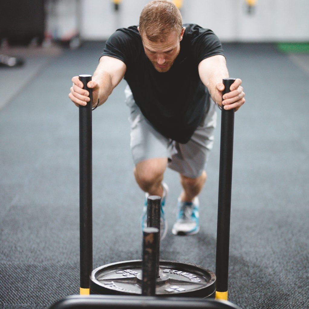 Athlete pushing weighted sled