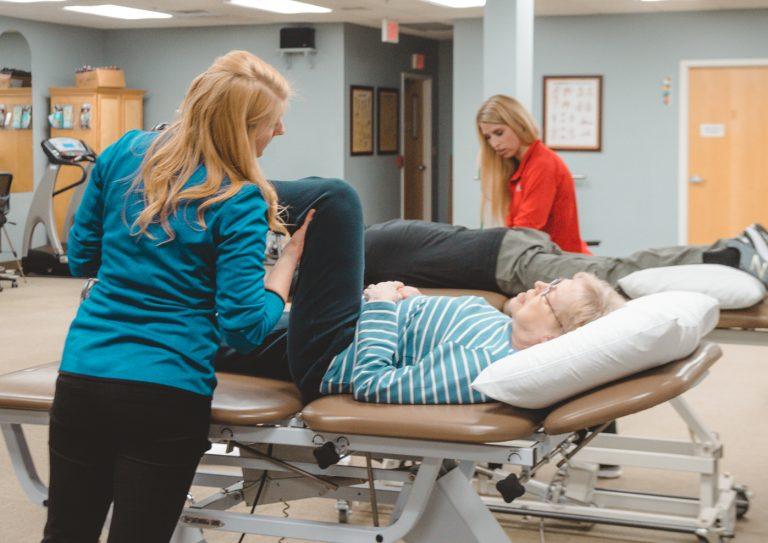 Therapist working on senior patient