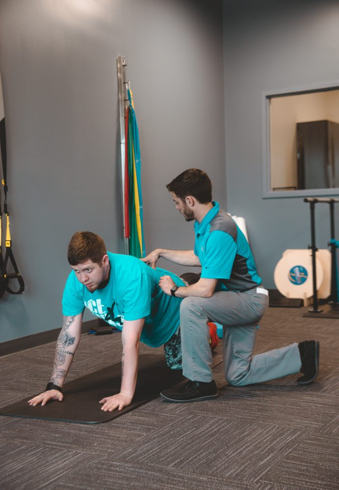 Therapist Helping man with exercise
