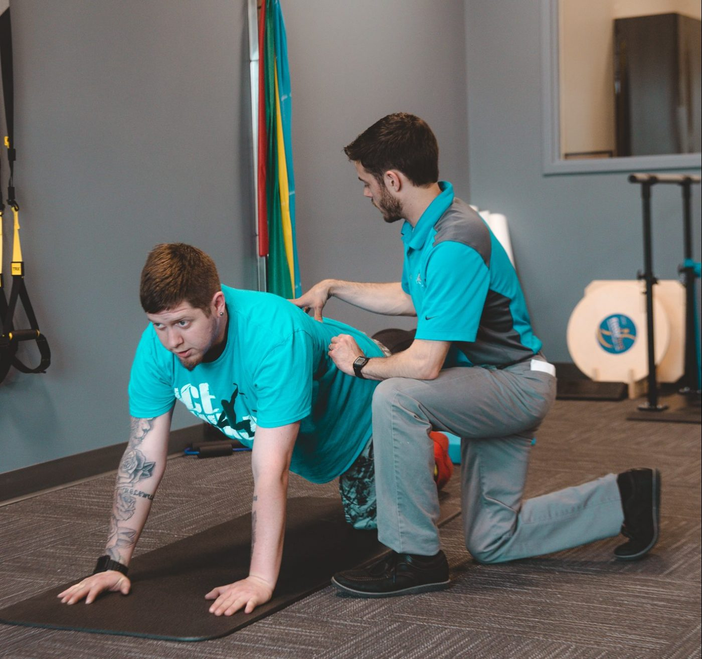 Therapist working on floor with patient