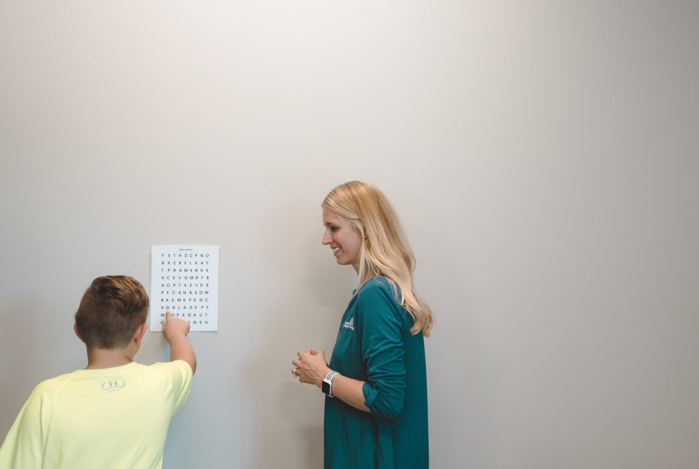 Therapist working with child on concussion rehabilitation