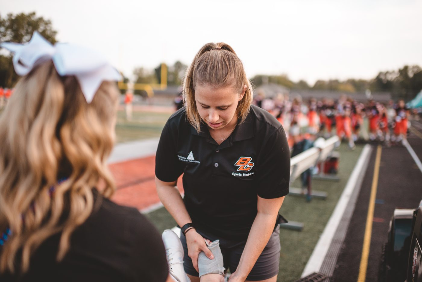 athletic trainer taping ankle