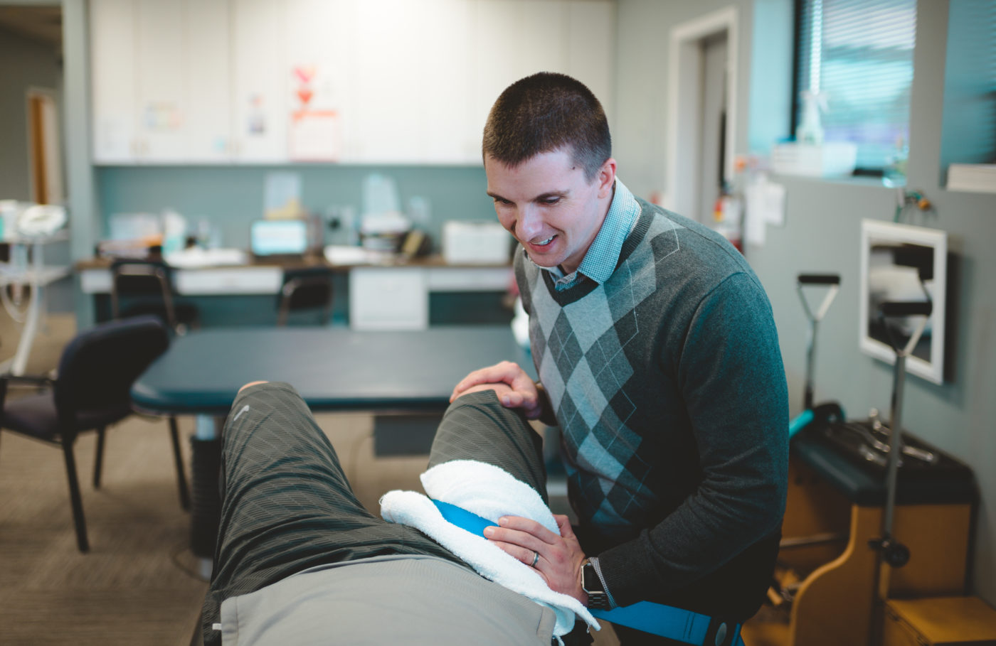 Therapist working on mans hip
