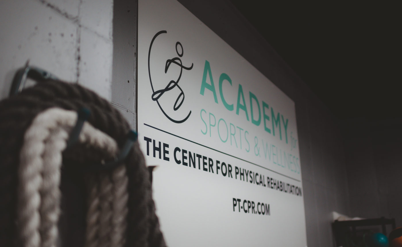 Academy for sports and wellness sign