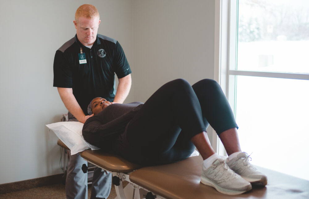 Therapist working on patients neck