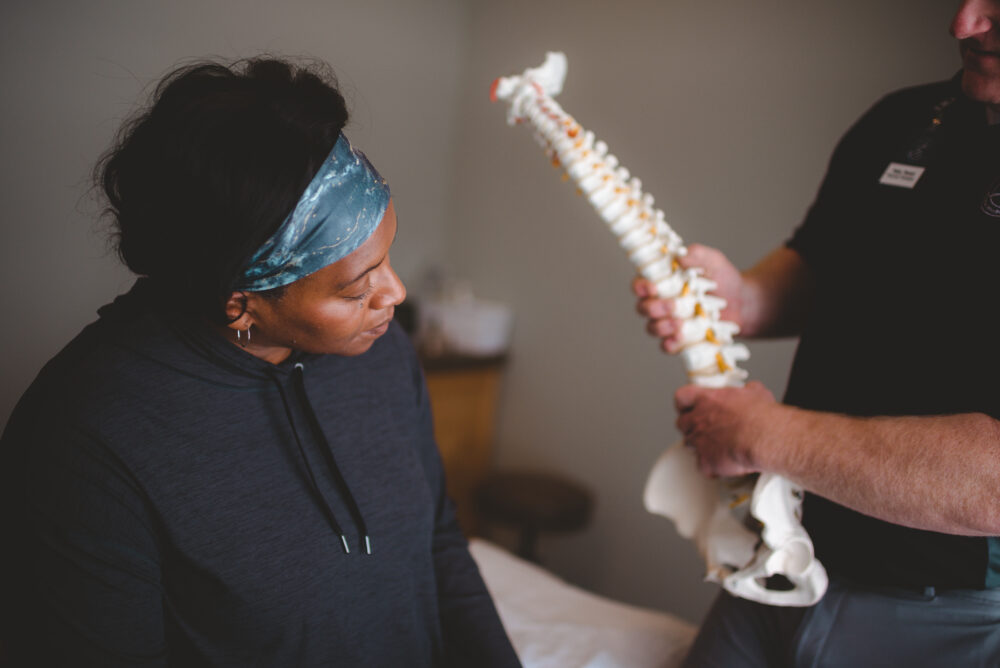 Therapist showing spine model