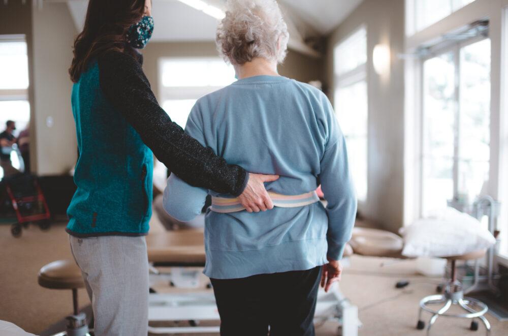 Therapist helping senior patient